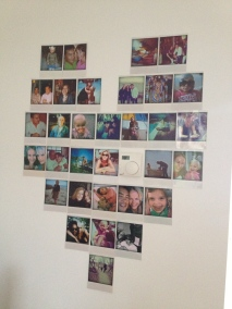 Decorating my wall with a heart of Polaroid photos